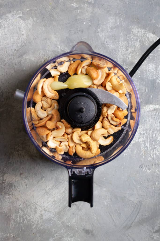 Add Nuts + Garlic to Food Processor