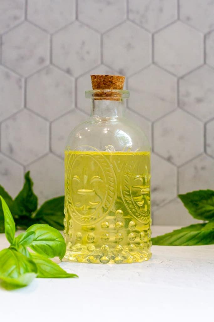 basil vinegar (basil flower vinegar) in a decorative jar