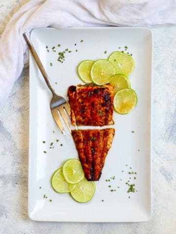 broiled black cod on a serving dish