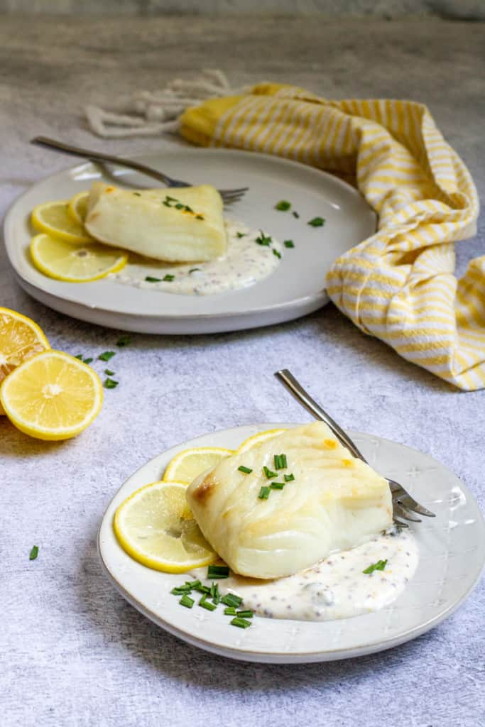 Broiled Halibut with Lemon Sauce on Plates