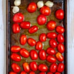 Place Tomatoes + Garlic on a Baking Sheet