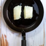 Place Halibut in an Oiled Pan