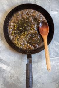 Add Lemon Juice, Capers, + Herbs to Pan