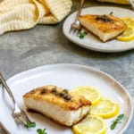 Pan-Seared Halibut with Lemon Caper Sauce on Plates