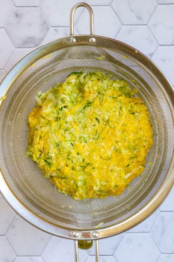 Squeeze Zucchini + Drain Moisture Into Bowl