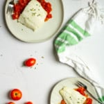baked lingcod on plates with tomato sauce