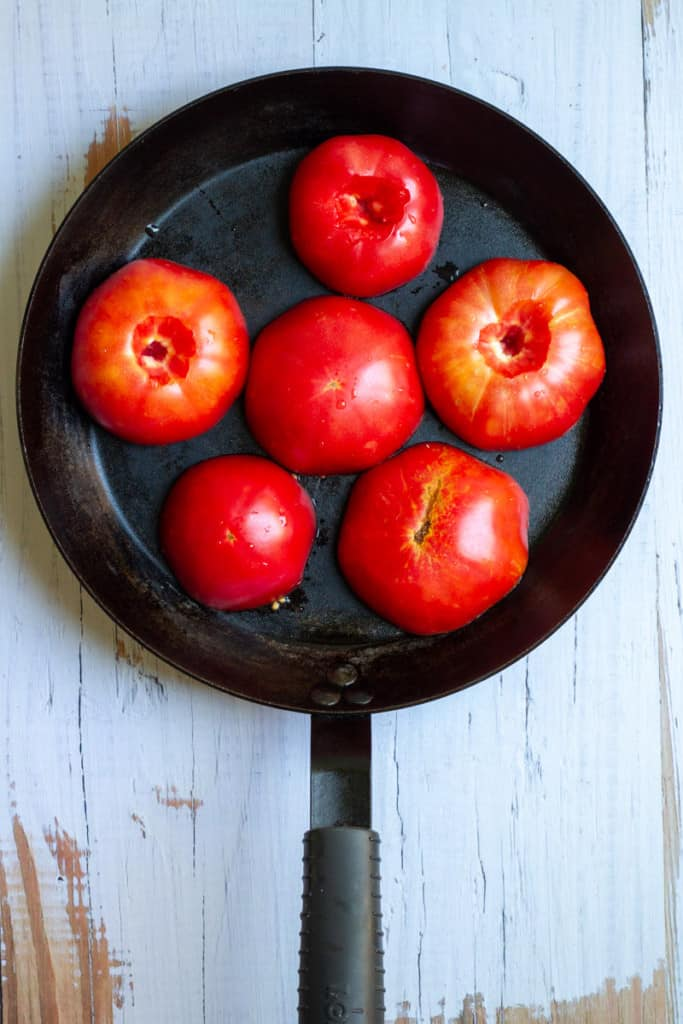 Place Tomatoes Cut-Side Down in an Oven-Safe Pan