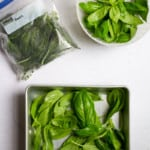 how to freeze basil (basil in freezer tray + bag)