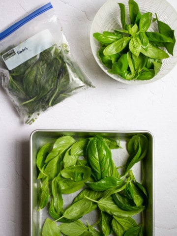 how to freeze basil (basil in freezer tray + bag)