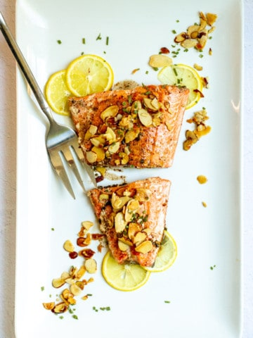 salmon almondine on a serving platter
