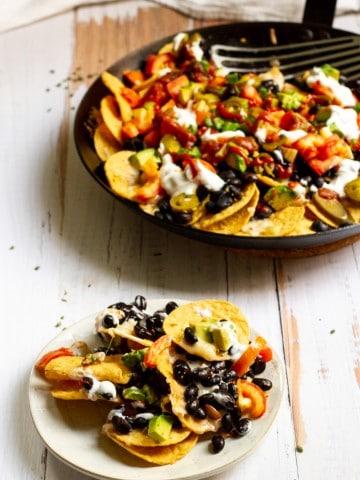 black bean nachos in a pan + plate