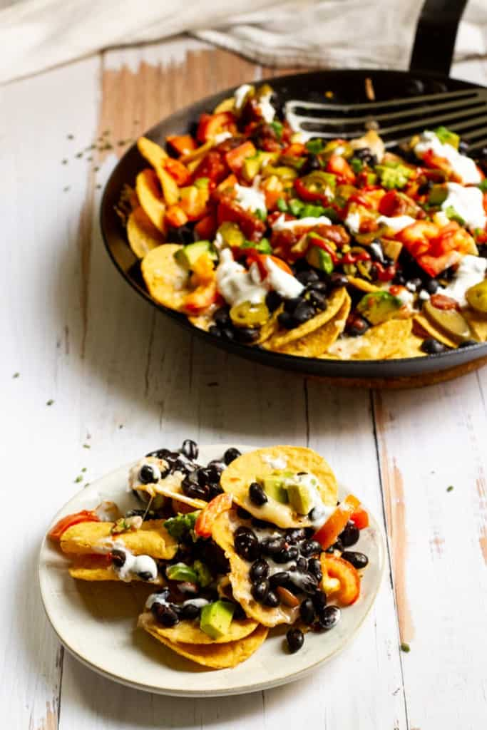 black bean nachos in a pan + plate