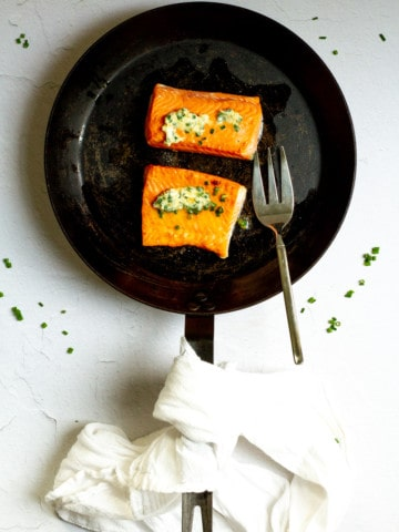 herb butter salmon in the pan after cooking