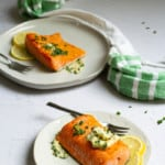 herb butter salmon on plates