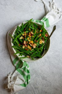 Toss Beans with Toasted Almonds (hericot vert salad in a bowl)