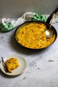spaghetti squash gratin in a pan and on a plate