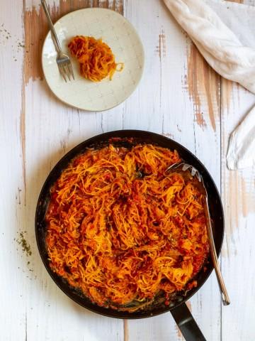 spaghetti squash marinara in a pan and on a plate