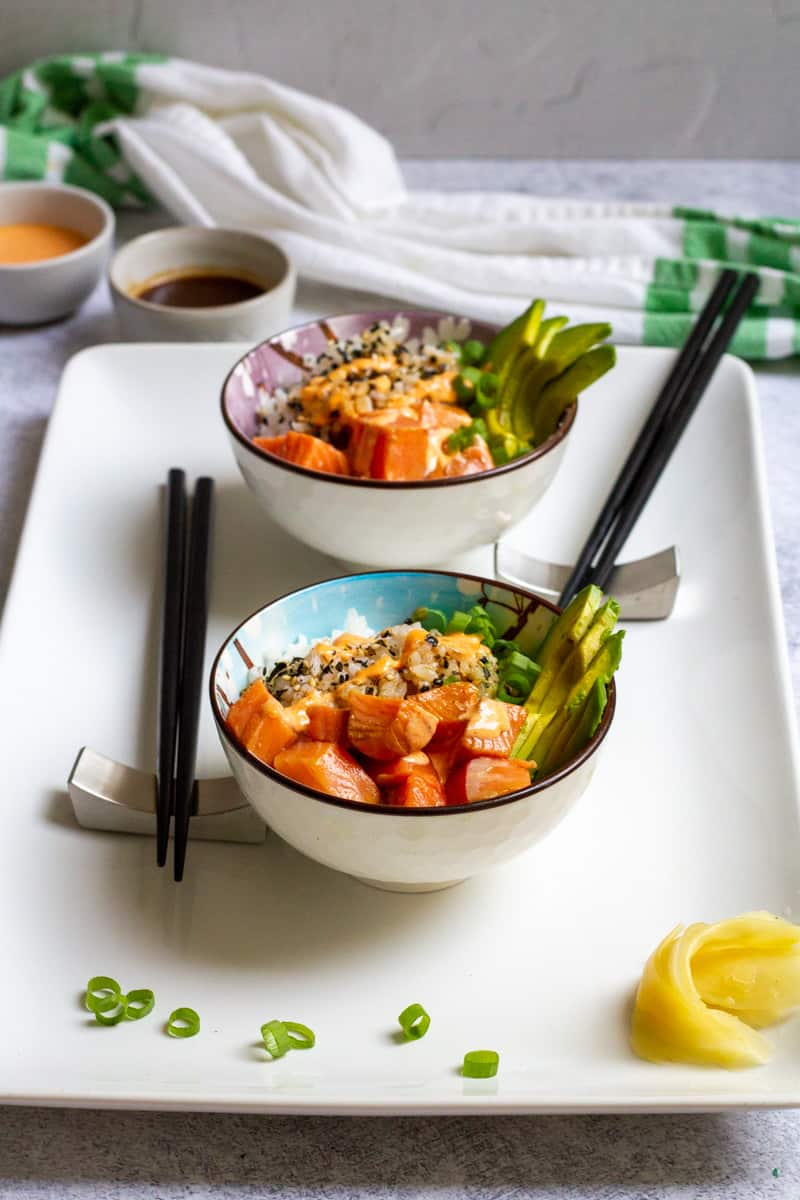 deconstructed sushi bowls on a serving tray.
