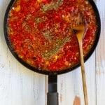 Add Tomatoes, Water + Oregano
