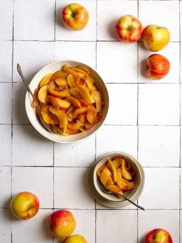 Bourbon Apples in a bowl and serving bowl