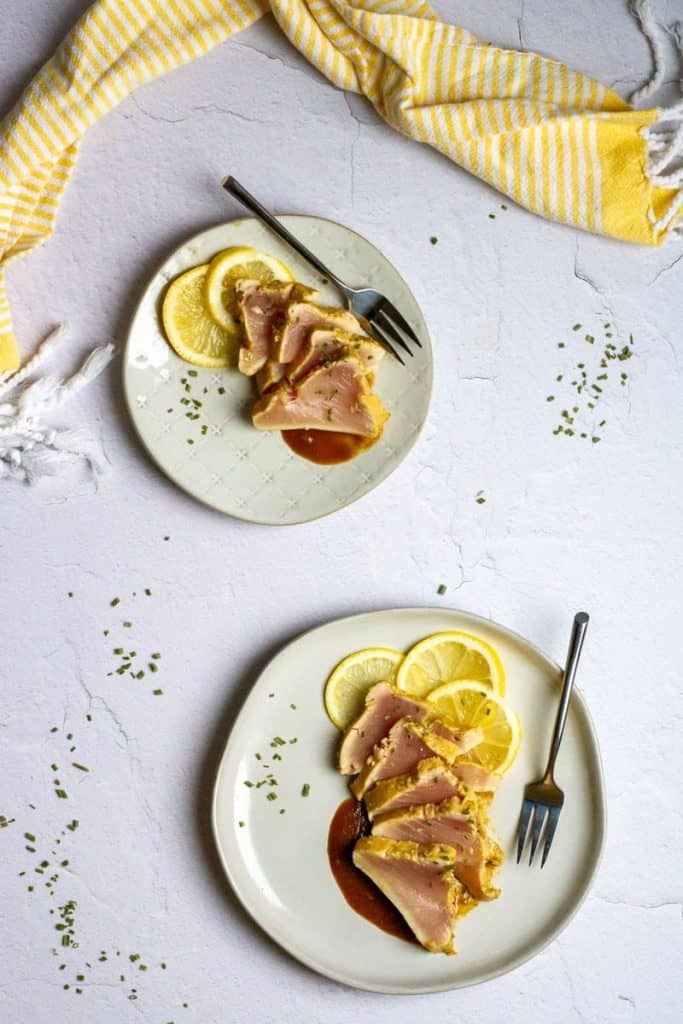 Seared albacore tuna slices on plates