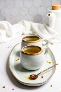 chamomile lavender tea in mugs with honey on a spoon