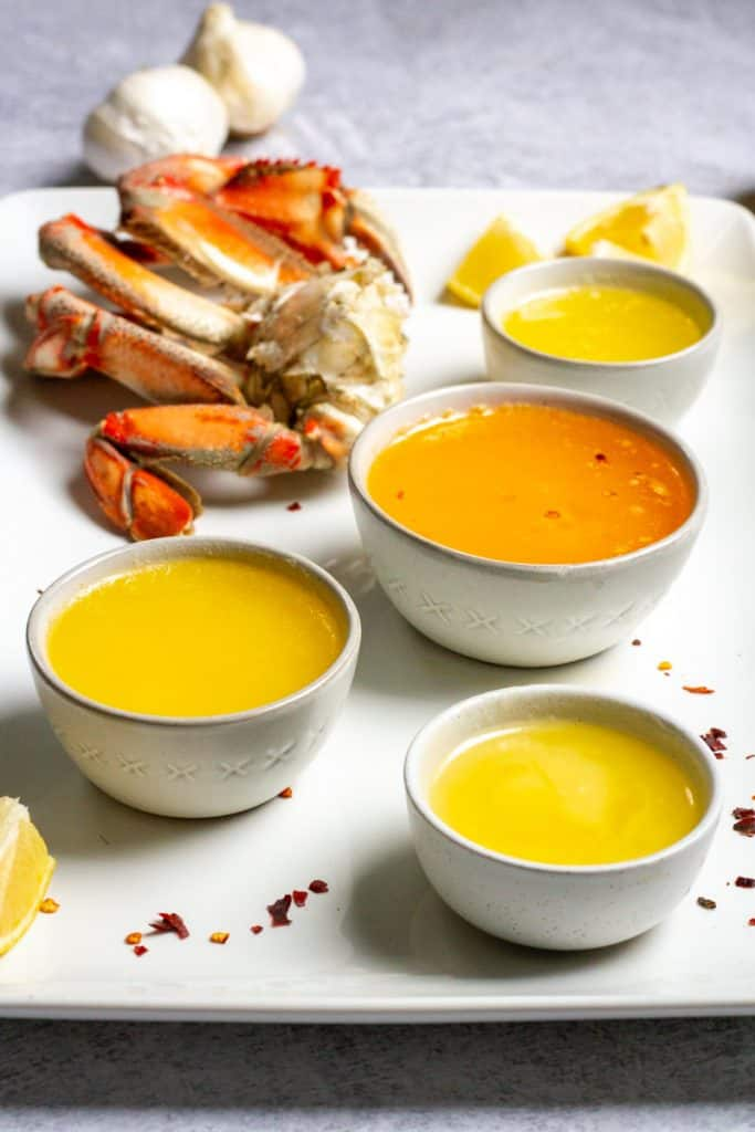 crab butter sauce on a platter with crab legs