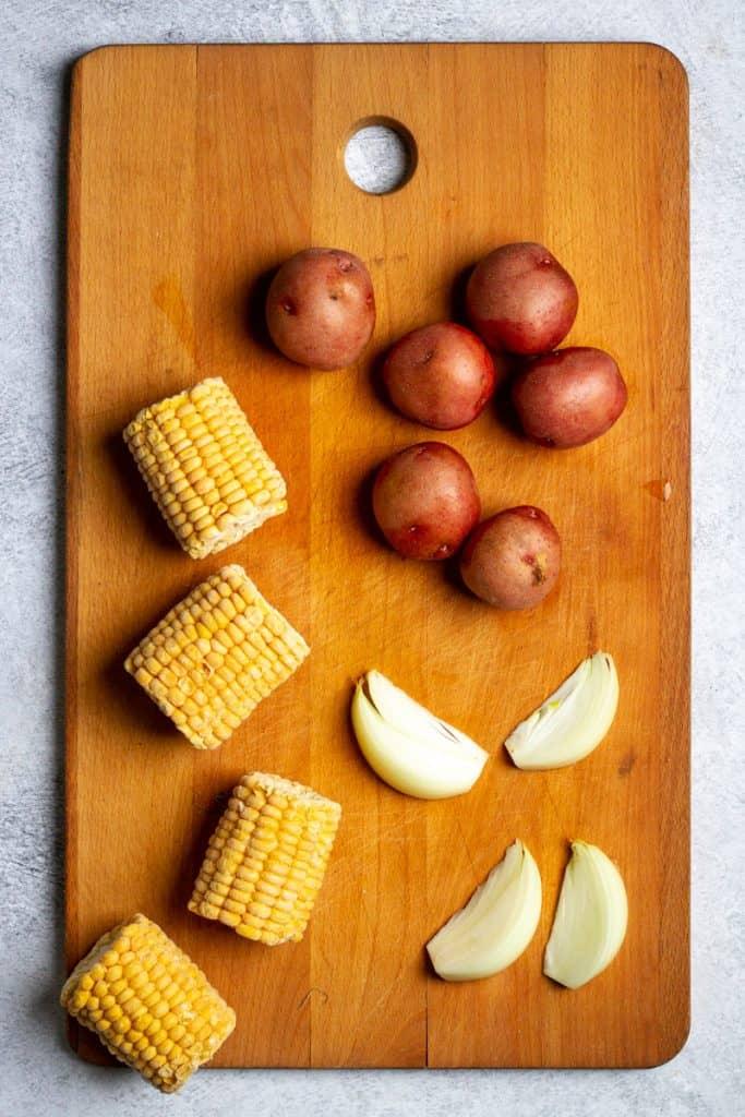 Add Potatoes, Onions + Corn