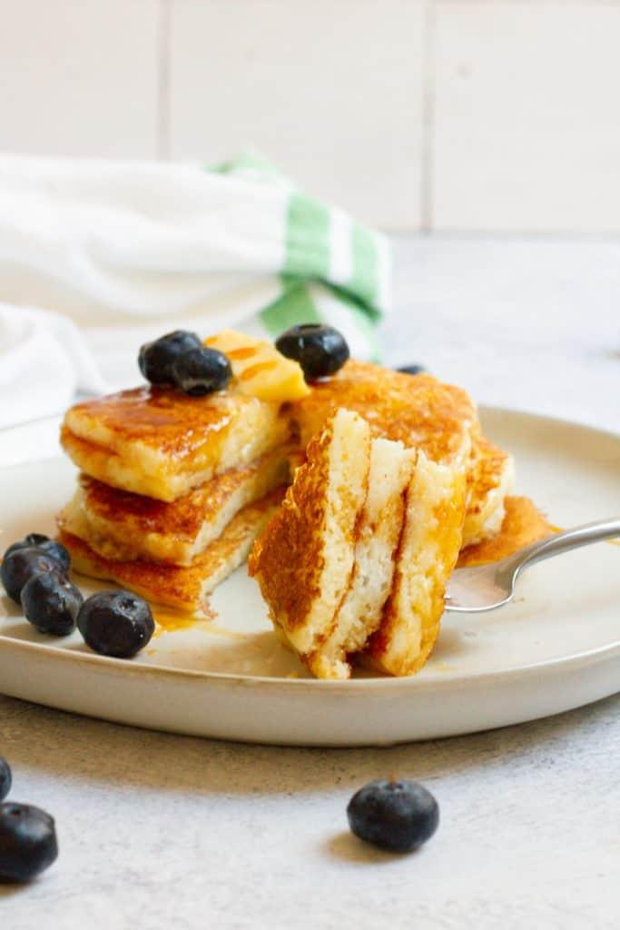 fluffy gluten-free sourdough pancakes on a plate