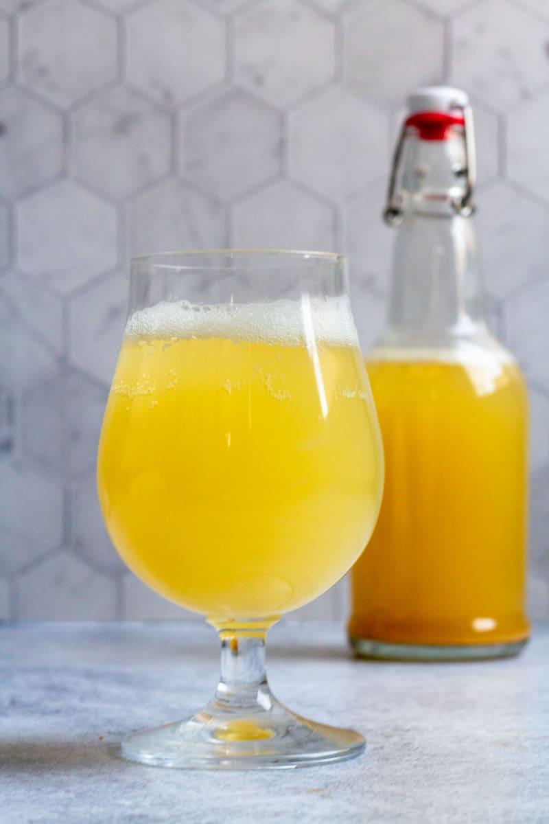 hard kombucha in a bottle and glass