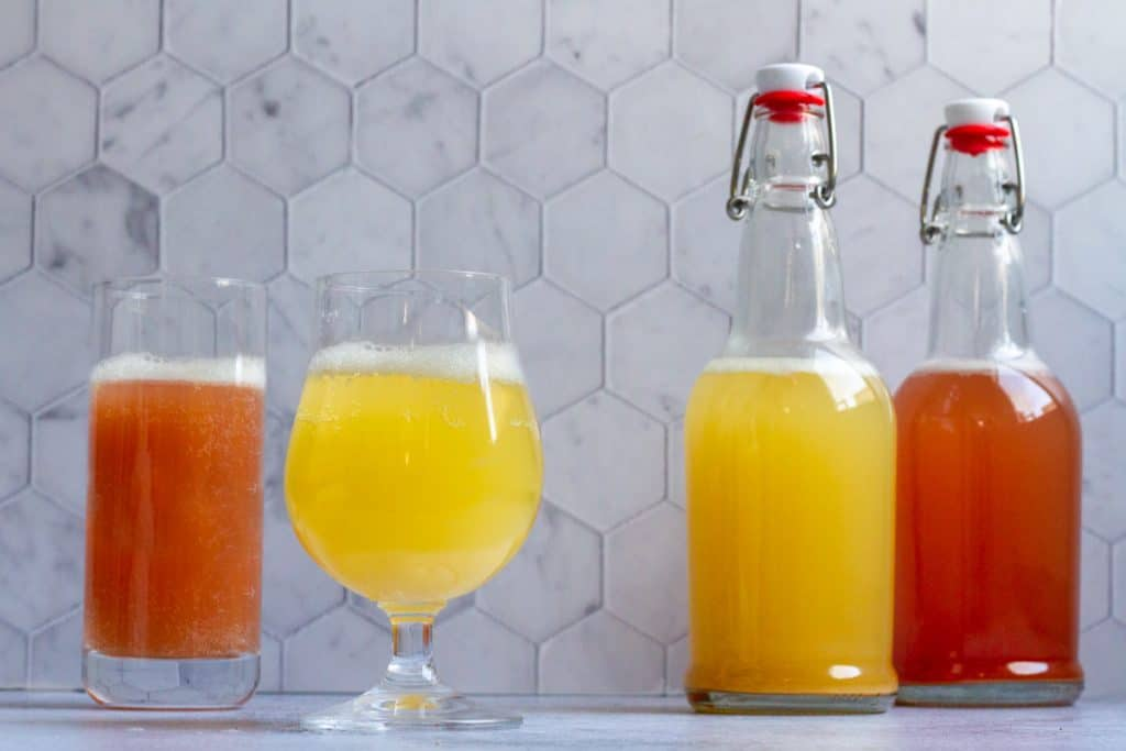 hard kombucha in bottles and glasses