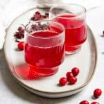 cranberry hibiscus tea in teacups on a platter