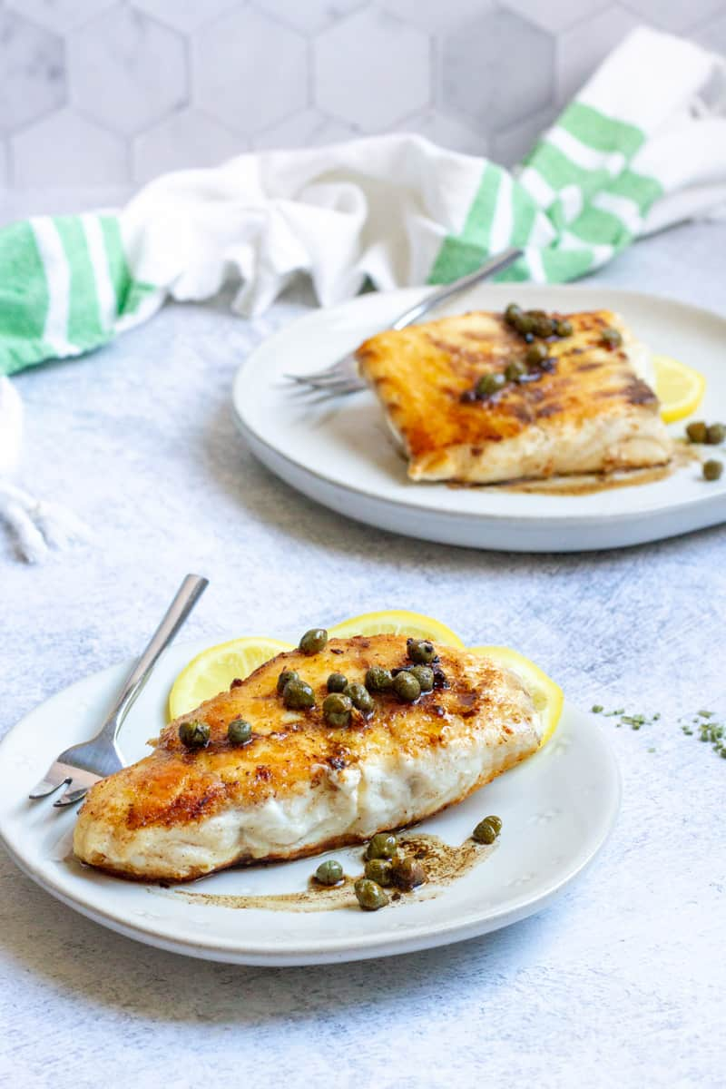 pan-seared red snapper on plates