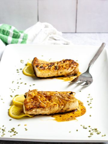 pan-seared black cod (sablefish) with brown butter sauce on a serving platter
