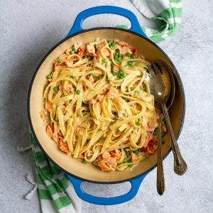 smoked salmon fettuccine alfredo in a serving bowl