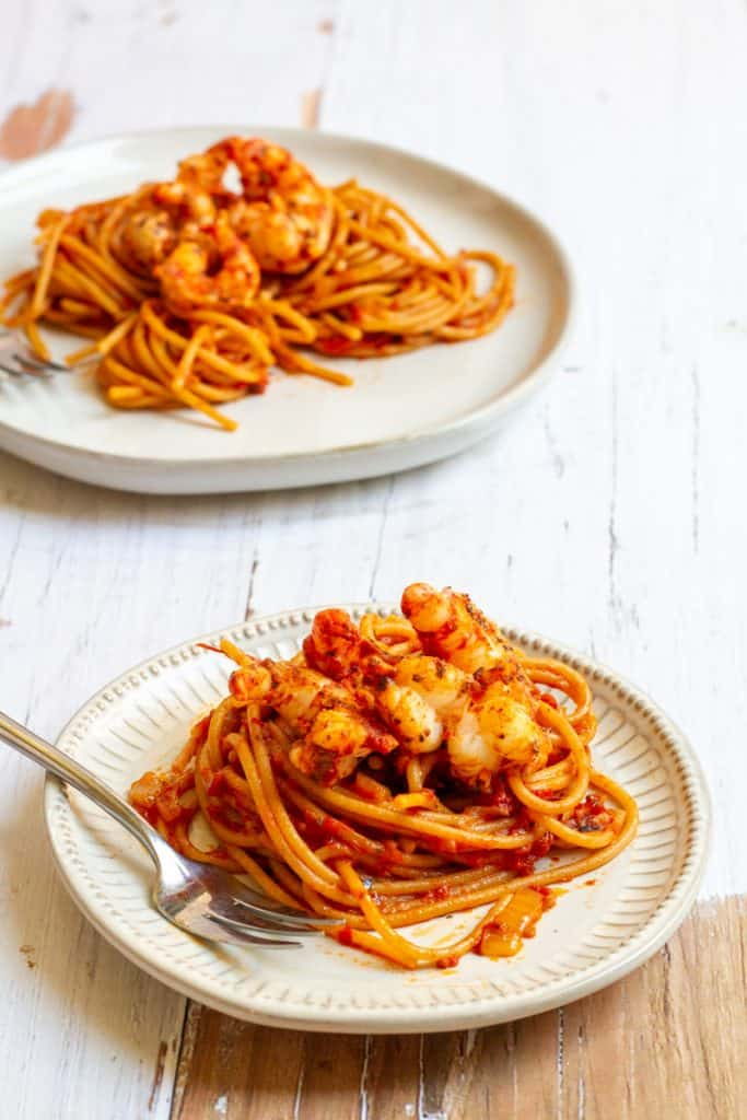 blackened shrimp pasta on plates