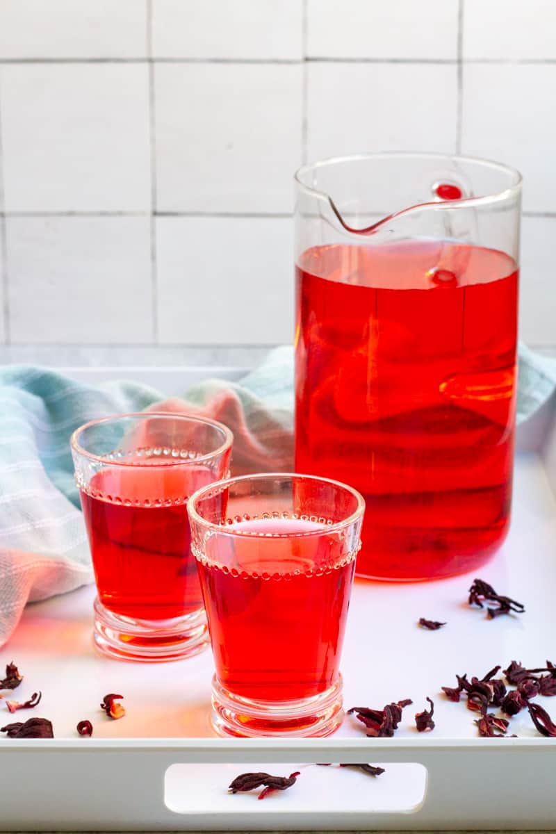 cold-brew hibiscus tea in a pitcher and in glasses