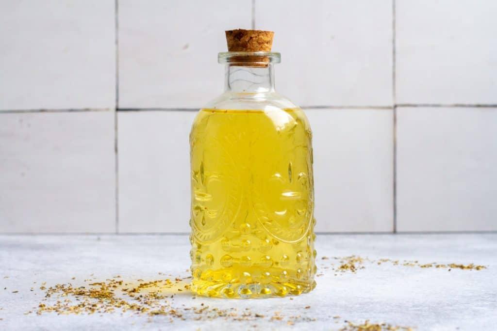 oregano vinegar in a glass bottle