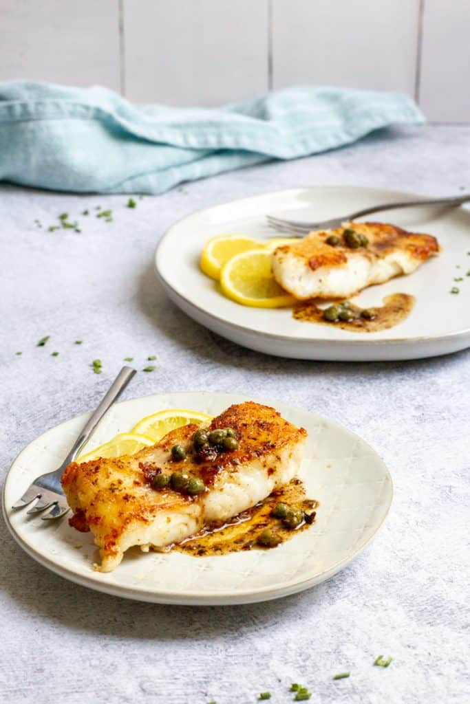 pan-seared grouper with butter caper sauce on plates