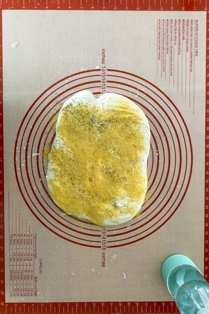 Spread Dough + Add Herb, Garlic + Nutritional Yeast