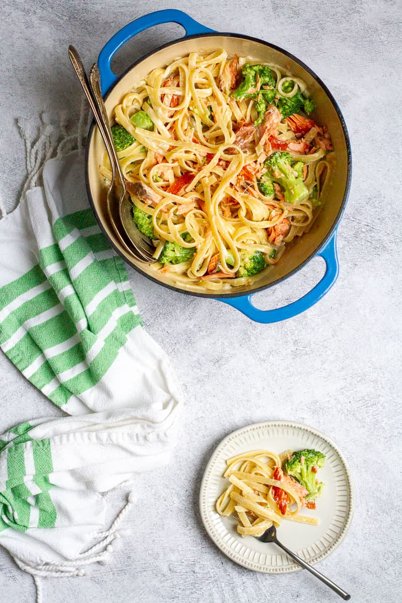 salmon broccoli pasta in a serving dish and on a plate