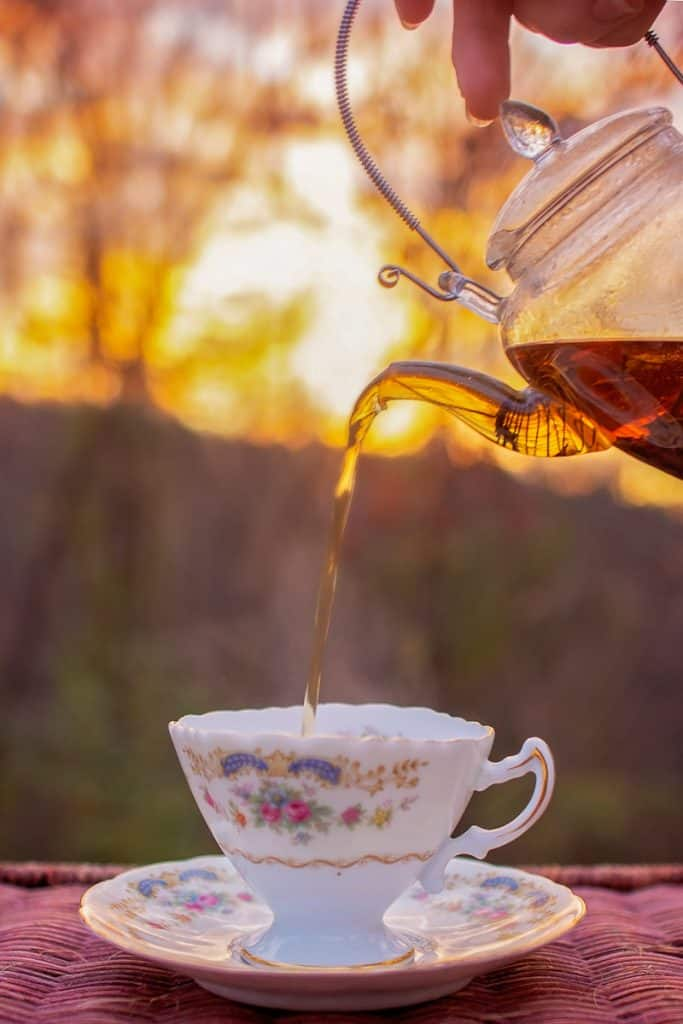 pouring tea from glass teapot