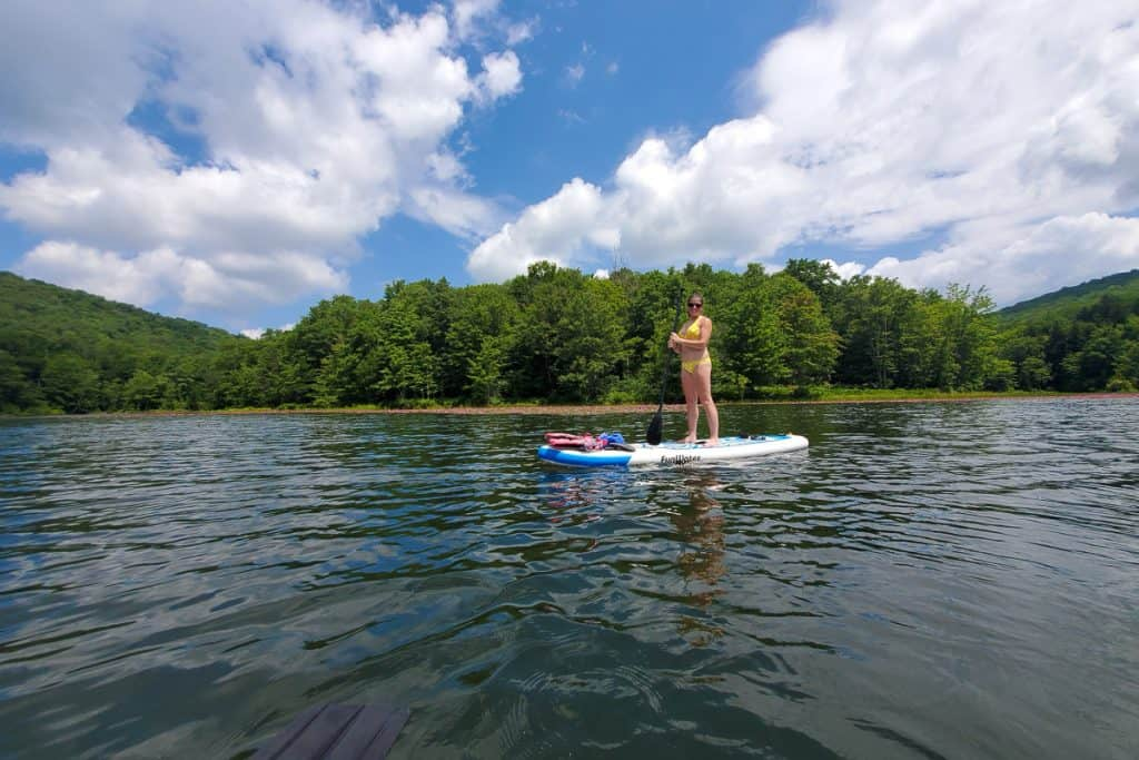 Woman on paddleboard in middle of lake