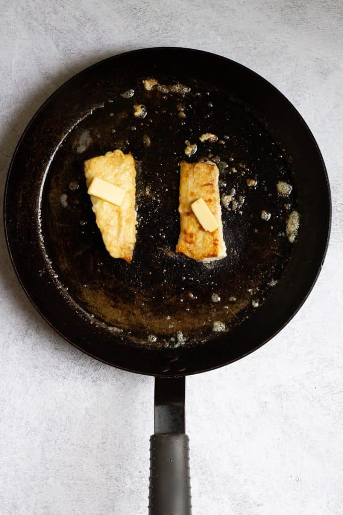 Flip Haddock + Top with Butter
