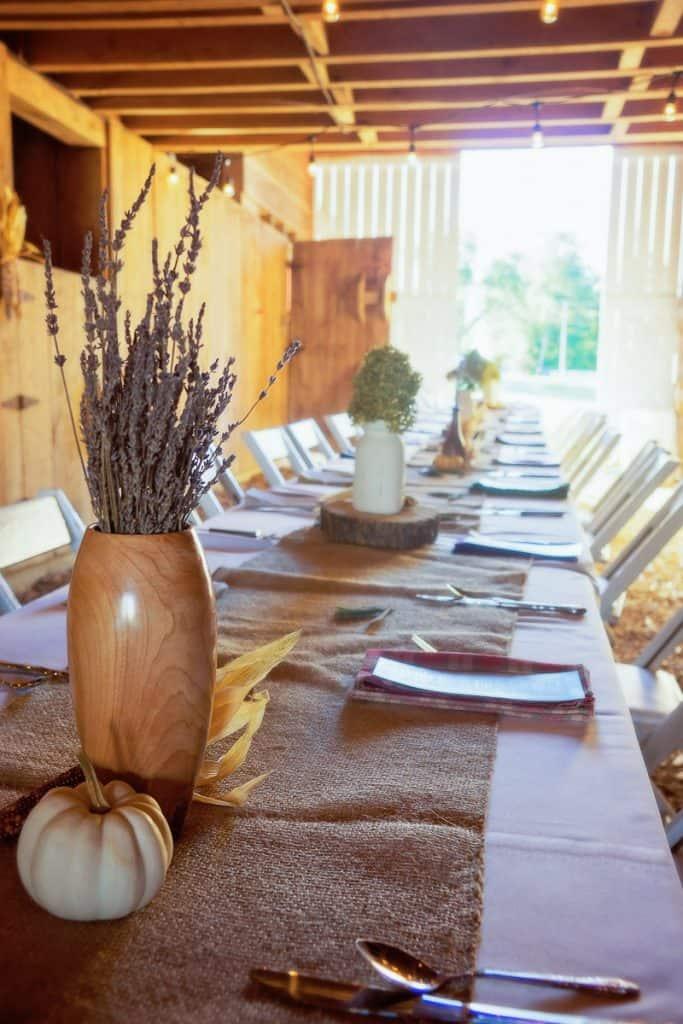 Table set for dinner inside barn