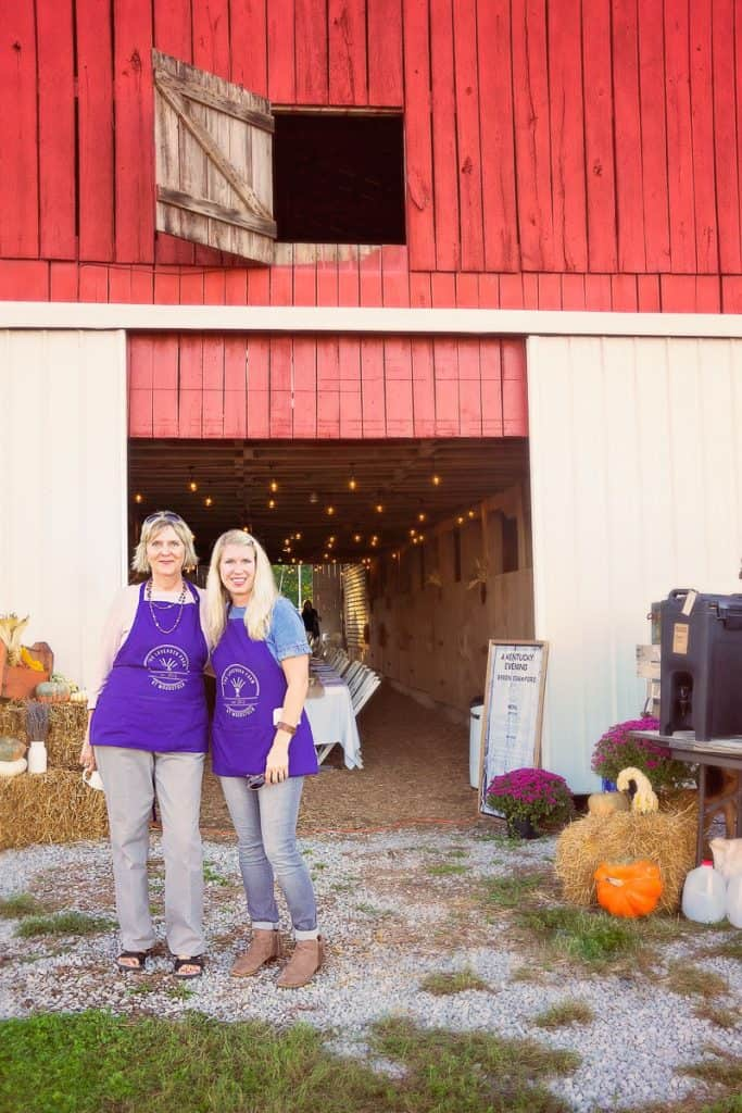 Woodstock Lavender Company owners standing outside barn