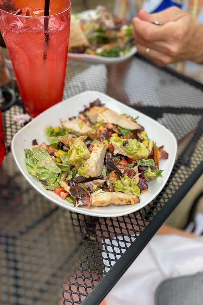 Salad with chicken, corn, bacon, at Bella's