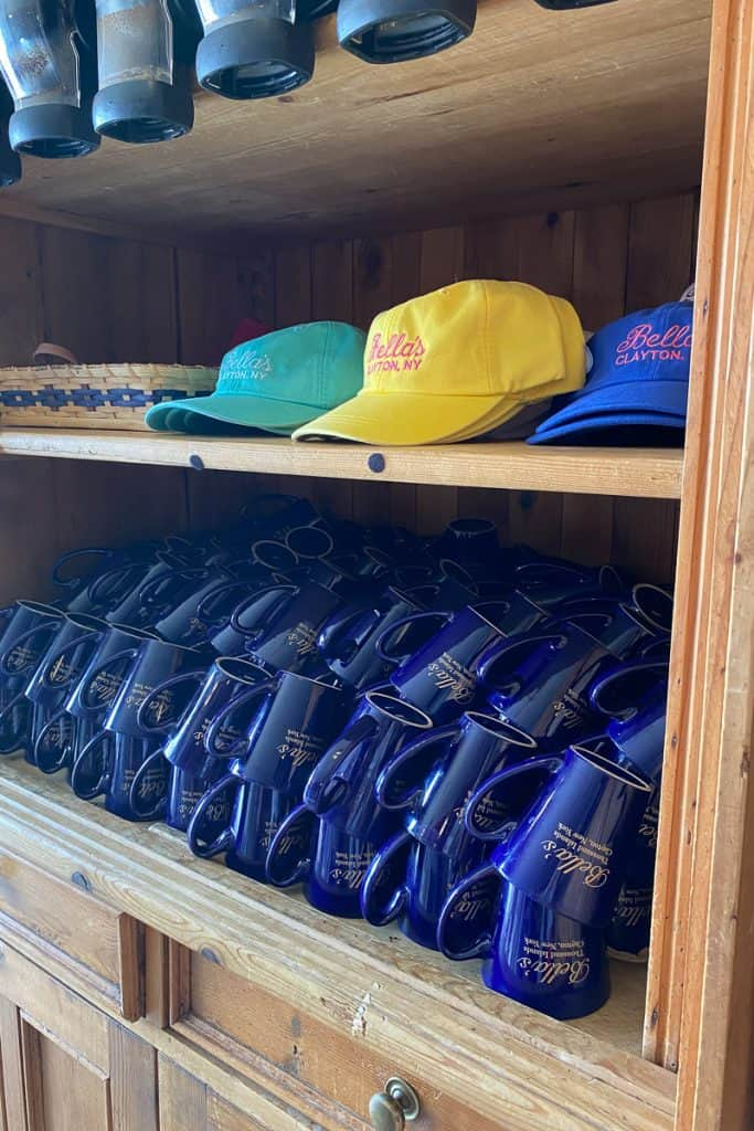 Souvenir coffee cups and hats for sale at Bella's in Thousand Islands region, Clayton, NY