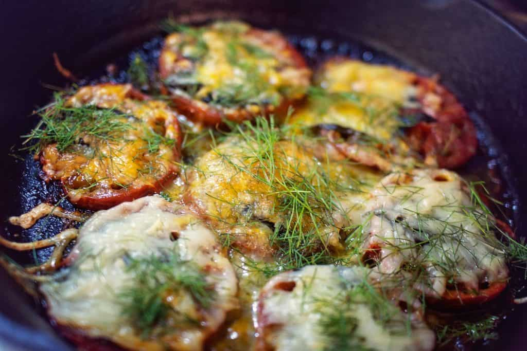 Tomato steaks in a cast-iron skillet