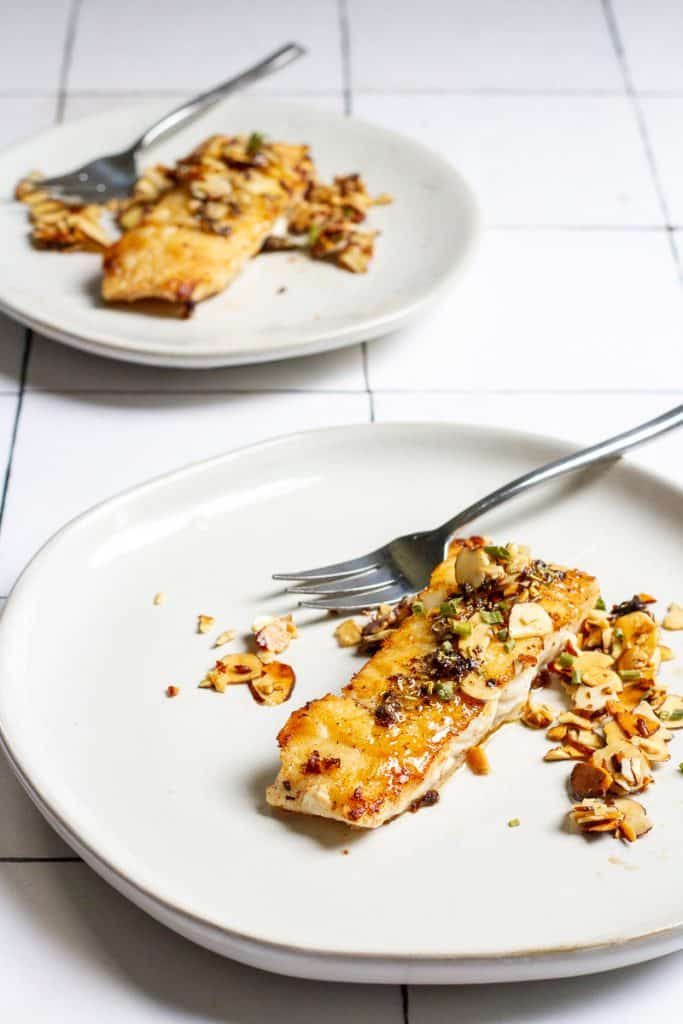 fish almondine on plates.